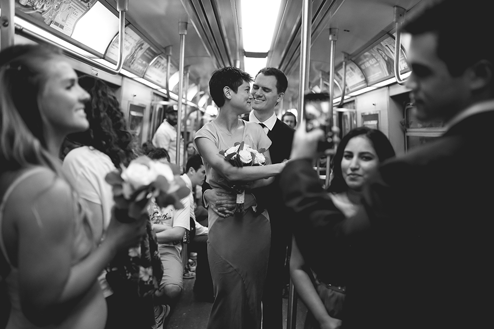 bride and groom in new york subway