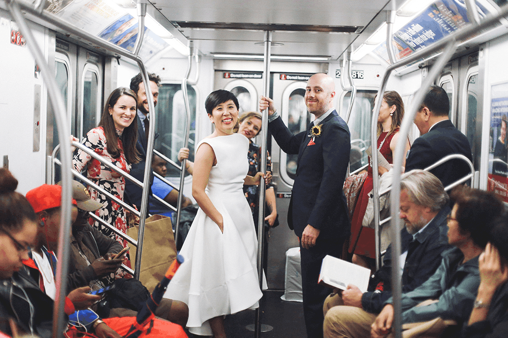 bride and groom riding the subway
