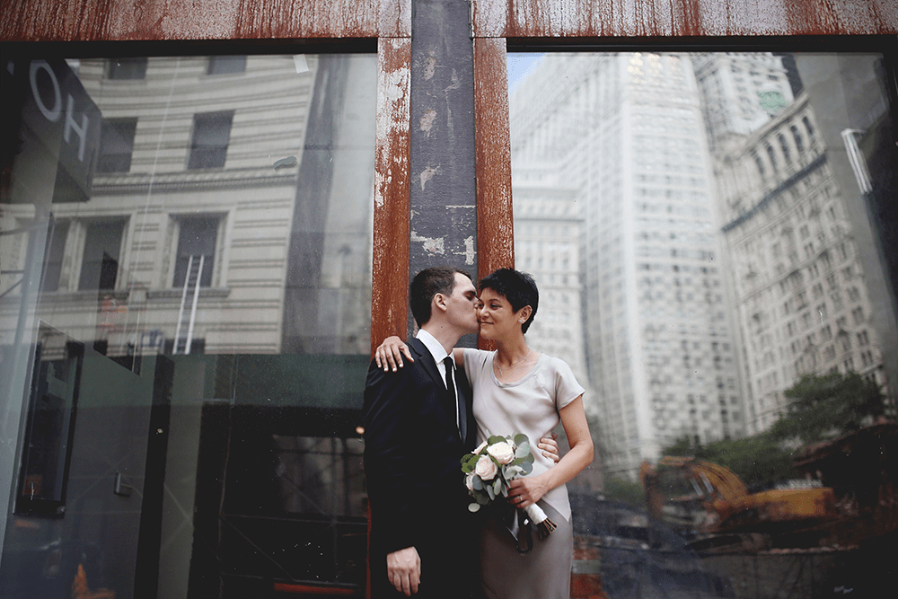 bride and groom in the financial district