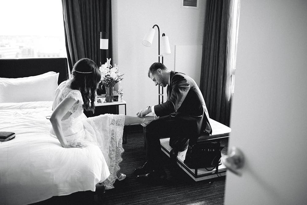 bride and groom getting ready together