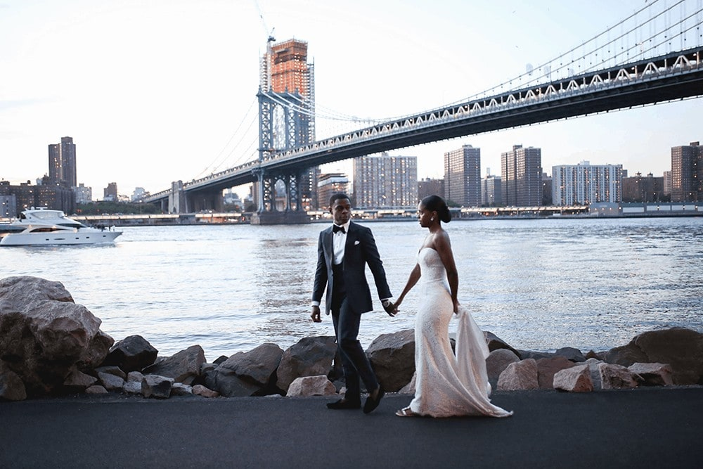 Bride and groom portraits in cobblestone streets in Dumbo