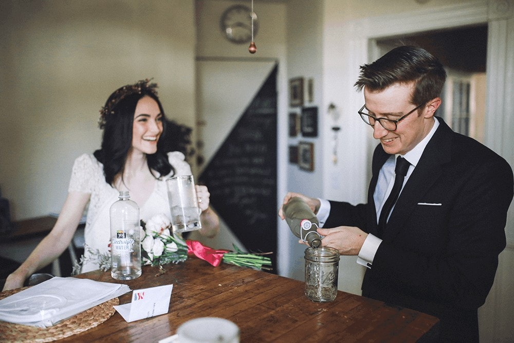 bride and groom getting ready together at home in brooklyn