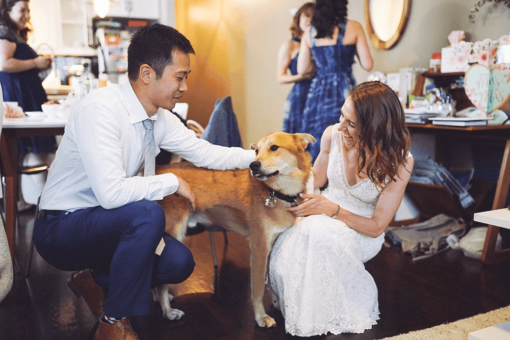 bride and groom get ready at home with dog